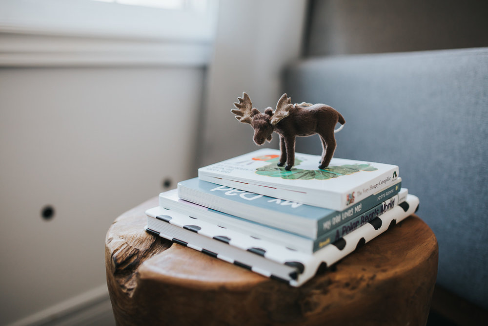nursery details, tree stump side table with children's books and moose toy - Newmarket lifestyle photos