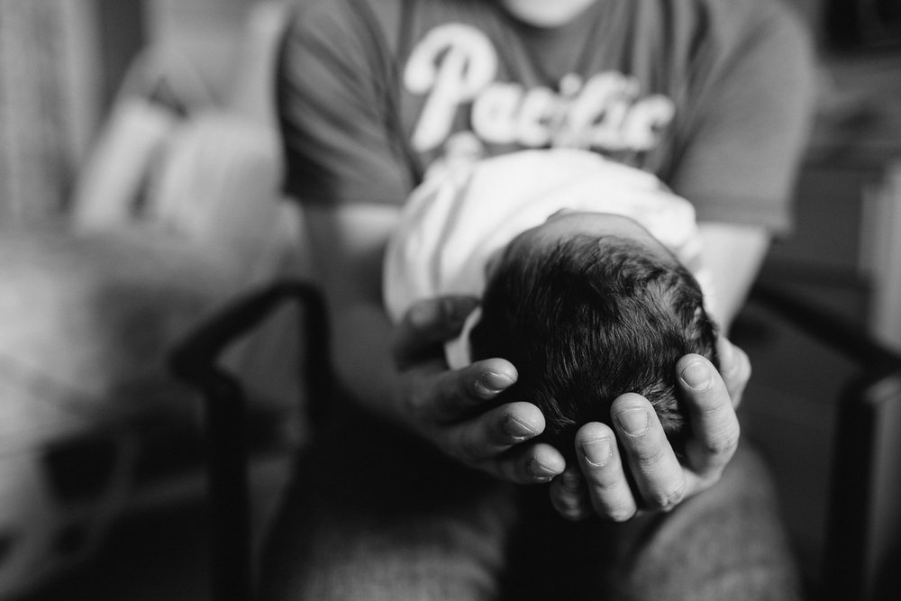 new dad holding 1 day old baby boy's head in hands - Markham Fresh 48 Photography