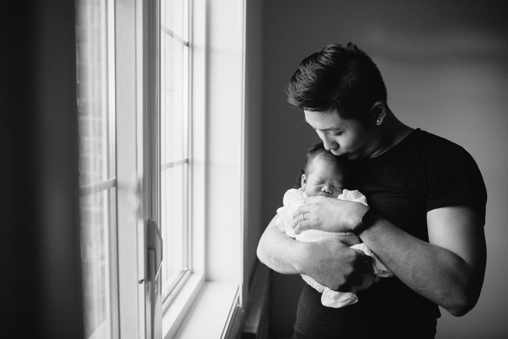 new dad holds 2 week old sleeping baby boy - Newmarket In-Home Photos