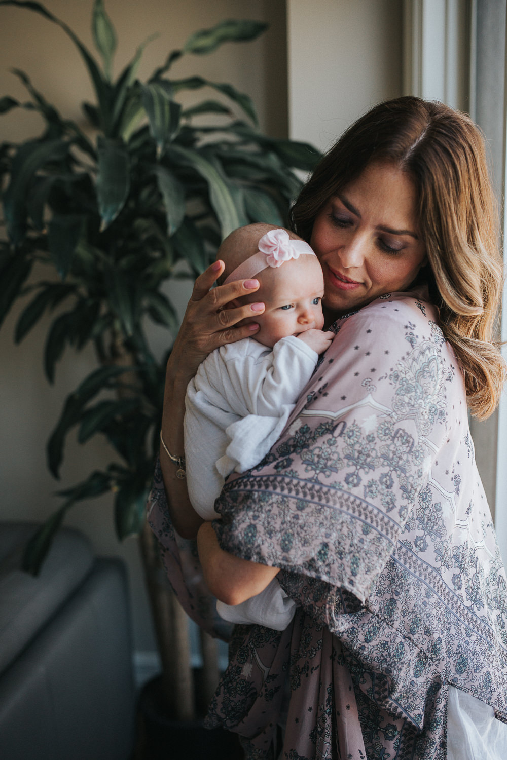 first time mom in flowered kimono holding 2 month old baby girl on shoulder - Barrie Lifestyle Photography