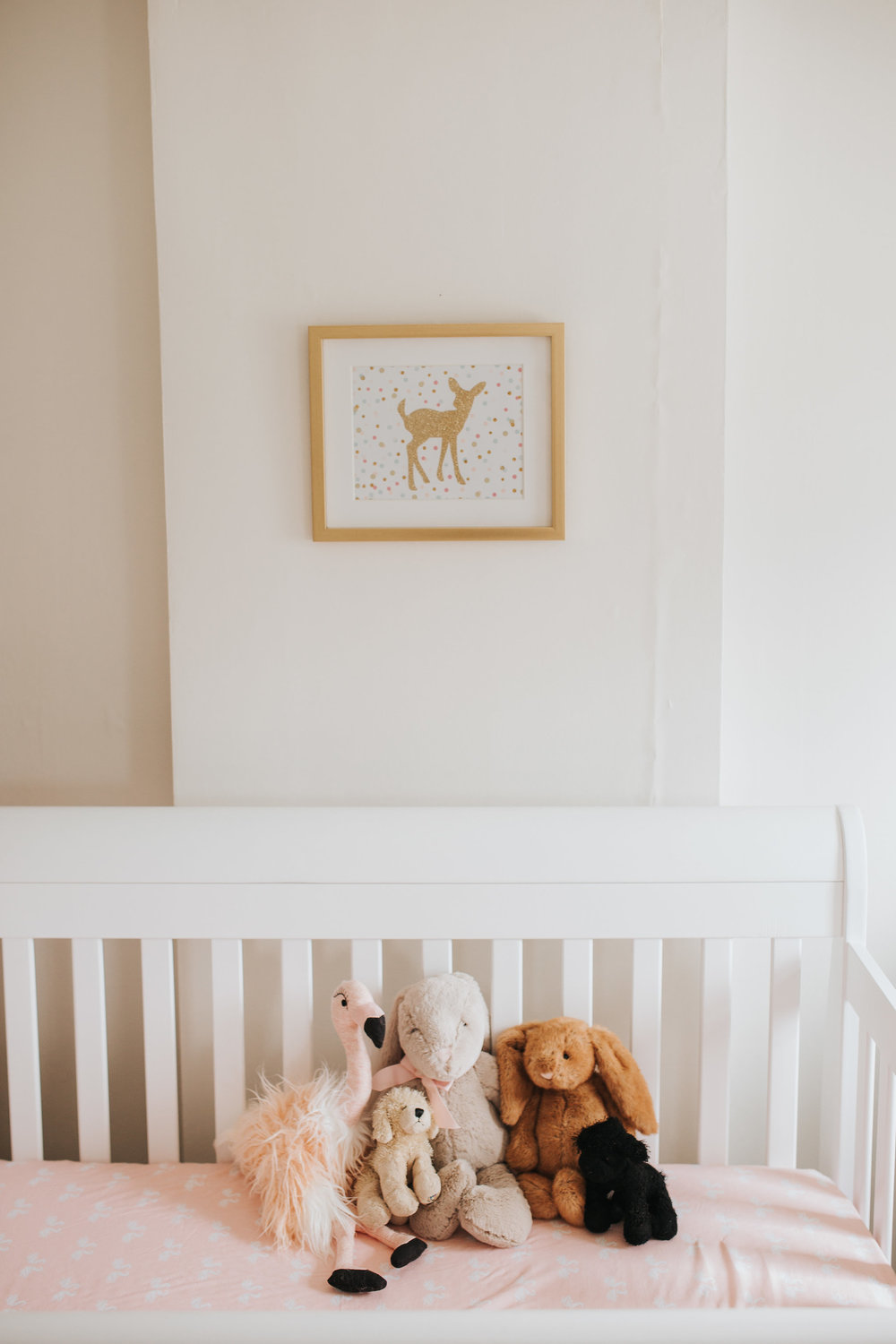 pink gold and white nursery details, stuffed animals in crib - Markham In-Home Photos
