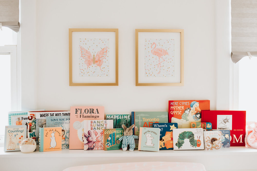 pink gold and white nursery details, baby books on shelf - Newmarket Lifestyle Photos