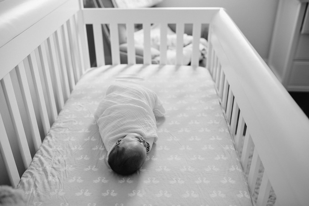 4 week old baby girl in white swaddle sleeping in crib - Stouffville Lifestyle Photography