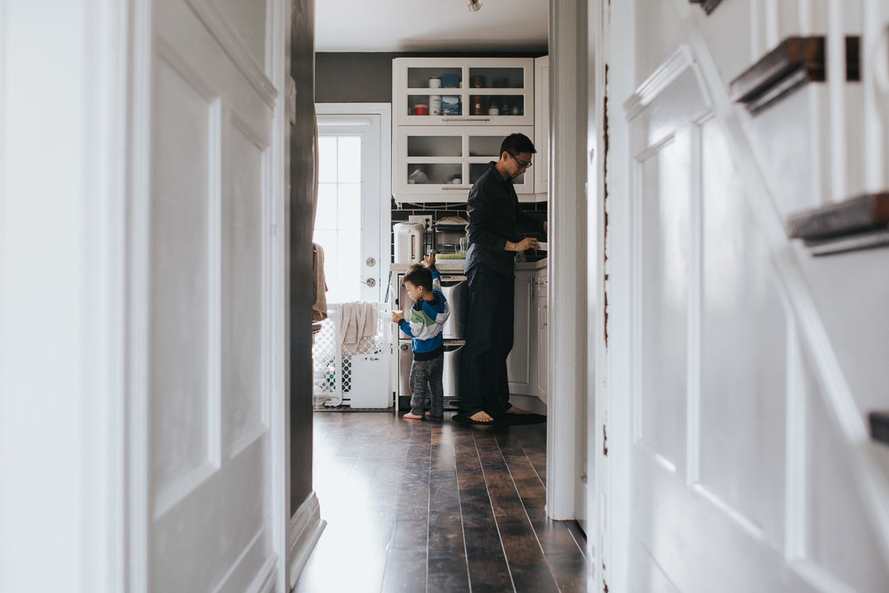 dad and 2 year old toddler son in kitchen, boy getting yogurt - Newmarket Lifestyle Photography