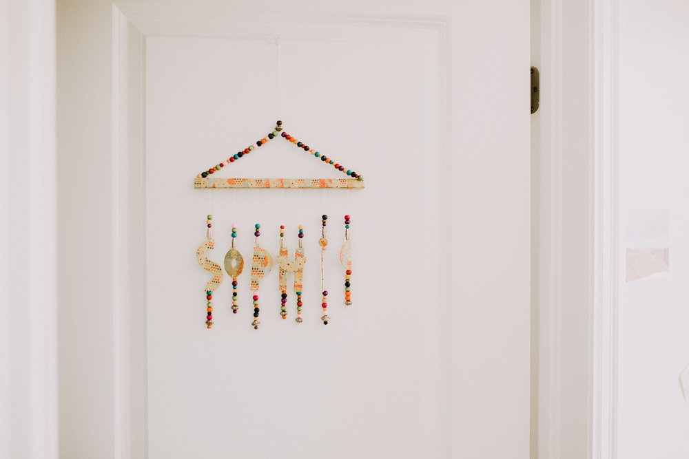 colourful beaded name decor hanging on nursery door - Stouffville In-Home Photos