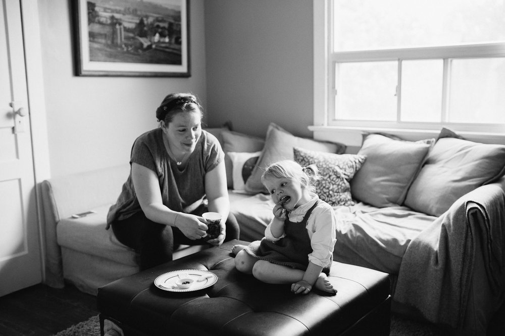 mom and daughter in living room eating snack - Markham Lifestyle Family Photography