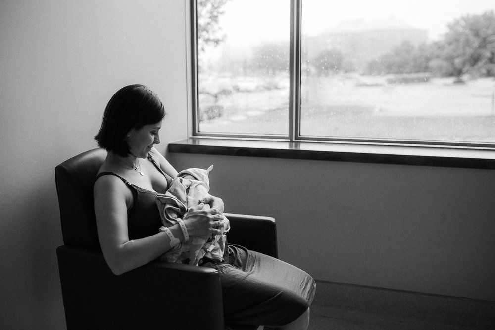 new mom sitting in chair holding 1 day old baby daughter - Barrie In-Hospital Photography
