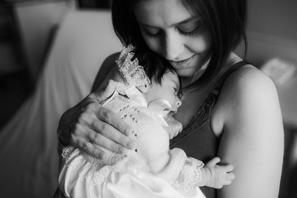 new mom cuddles 1 day old baby daughter to chest - Newmarket In-Hospital Photos