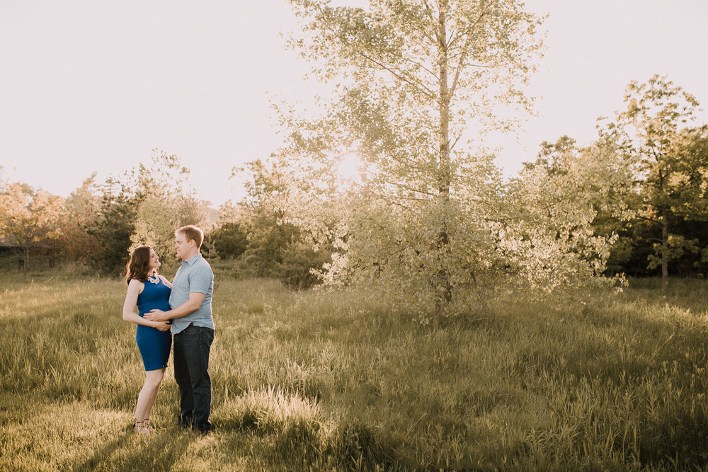 father-to-be and pregnant brunette wife in golden field at sunset - Barrie Lifestyle Photos