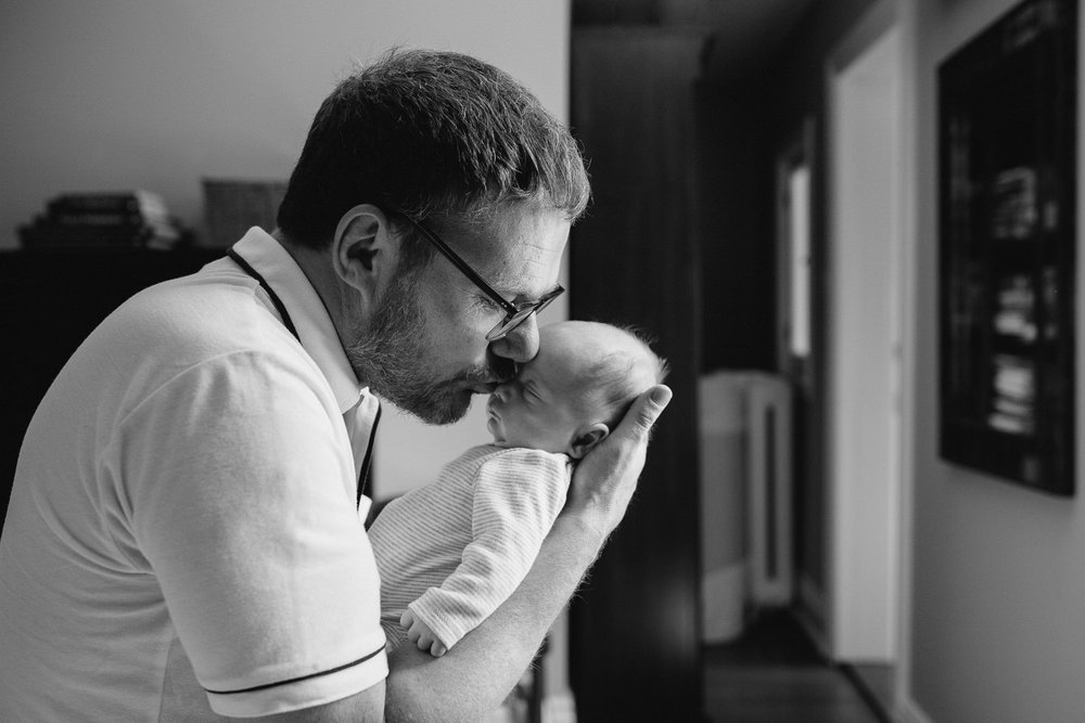new dad kisses 2 week old baby boy on face - Markham In-Home Photography