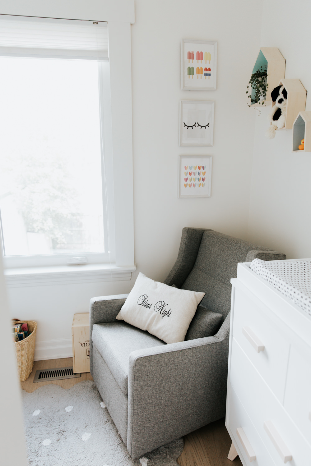 neutral nursery, white walls, grey glider and colour prints -Markham Lifestyle Photography
