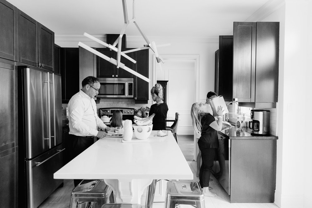 family of 5 in large modern kitchen preparing brunch together - GTA In-Home Photos