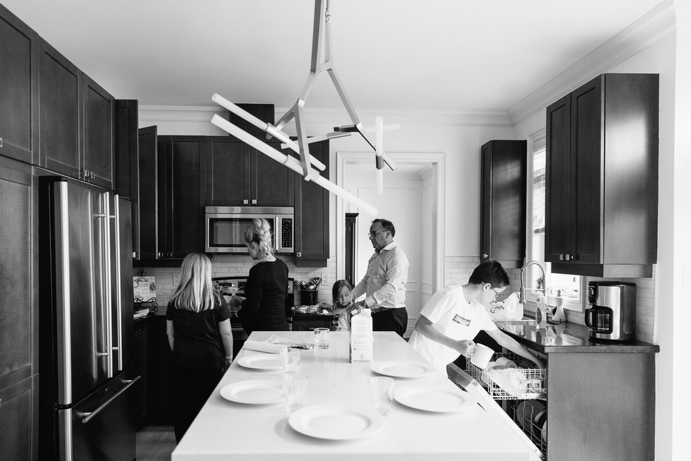 family of 5 in large modern kitchen, everyone working to set table and get food ready for brunch - Barrie In-Home Photos