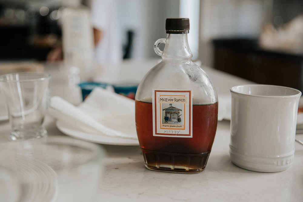 maple syrup on kitchen island set for family brunch - Markham Lifestyle Photos