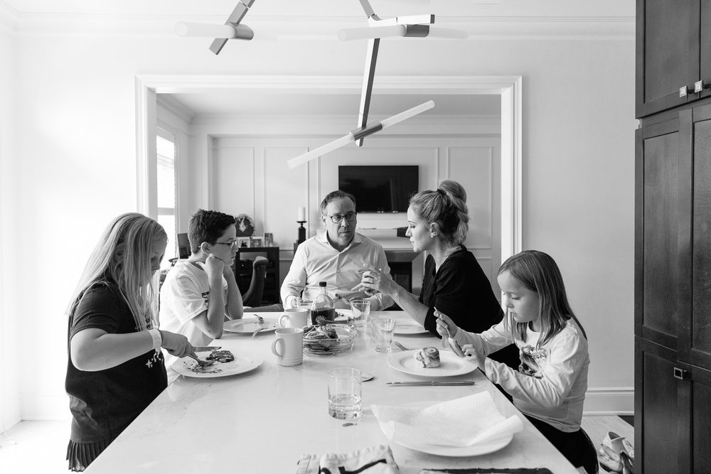 family of 5 sitting at kitchen island eating brunch together - Barrie Lifestyle Photos