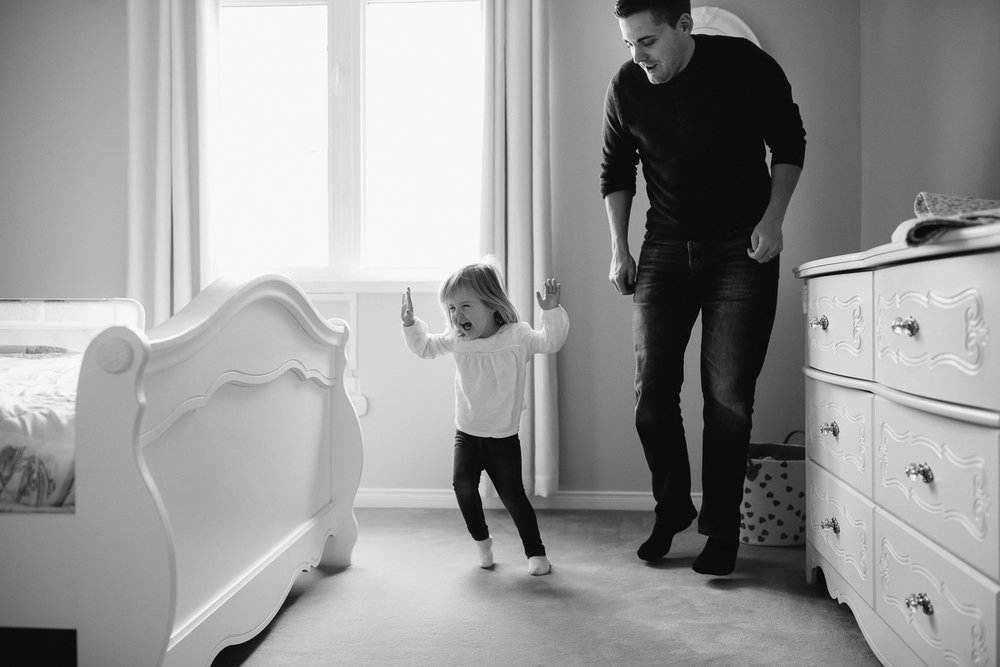 Blonde 2 year old toddler girl dancing in her bedroom with her dad - Stouffville In-Home Photos