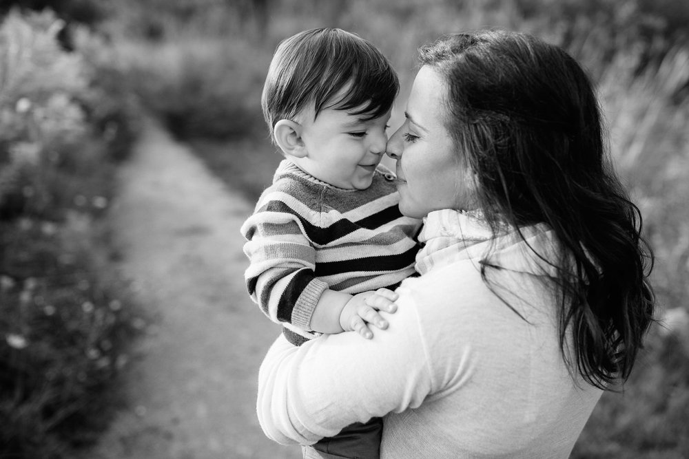 mom standing in golden field holding 1 year old baby boy, mother and son nose-to-nose, smiling - Barrie Lifestyle Photos