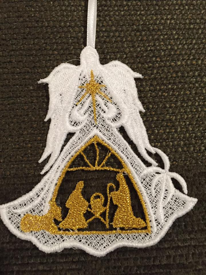 Angel of Light Gold Nativity.jpg