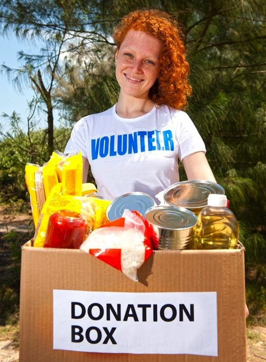 girl donating food crop.jpg