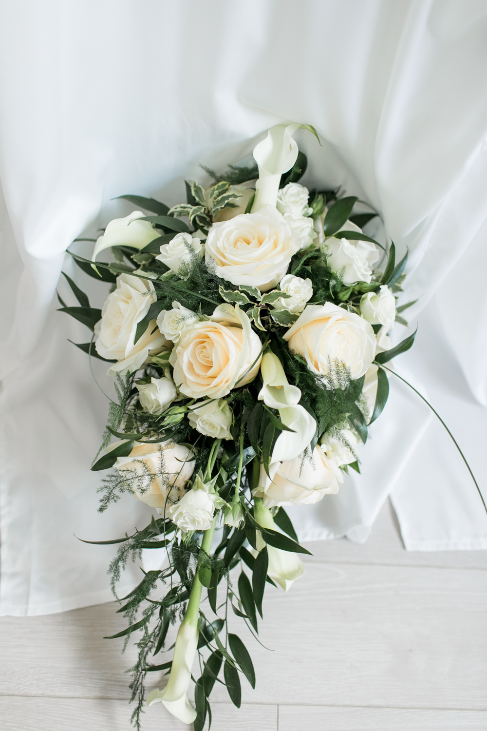 white roses with green foliage for wedding bouquet