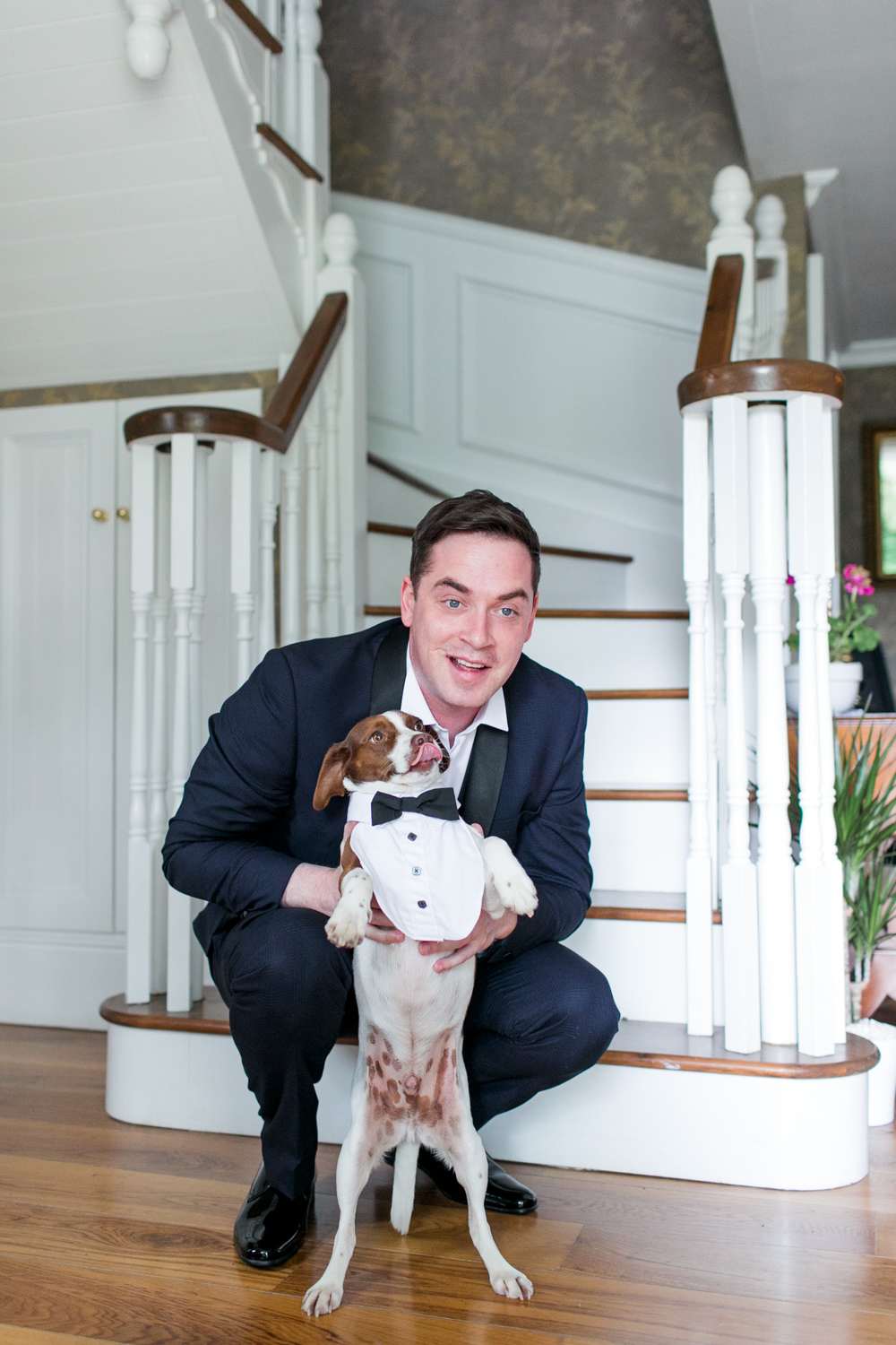 groom in the black tie tux with his jack russell dog wearing a cute tie