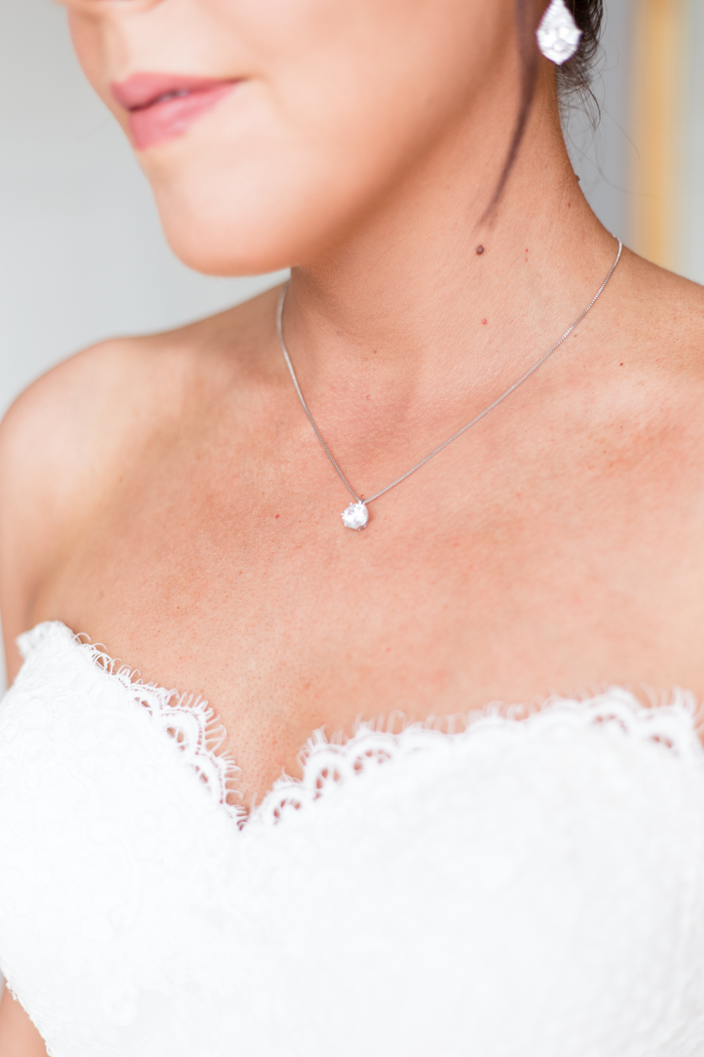 bride wearing delicate wedding jewellery