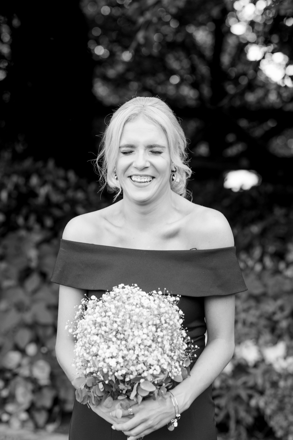 bridesmaids up style hairstyle with off shoulder black dress at slieve russell hotel ireland
