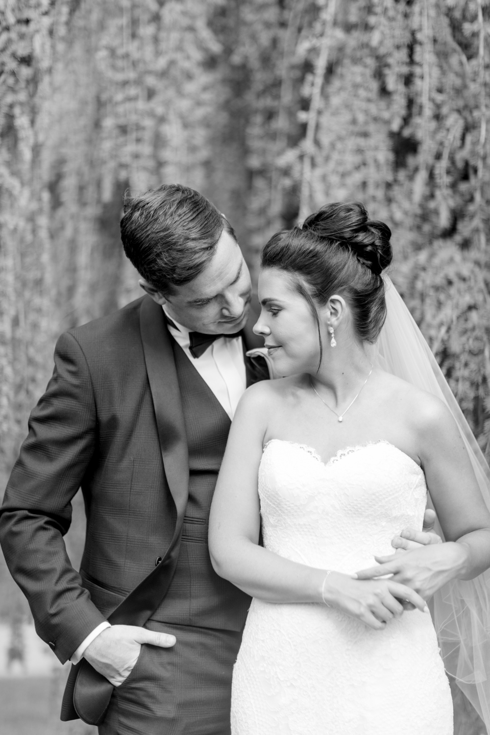 black and white photograph of bride and groom softly looking at each other at slieve russell hotel in ireland