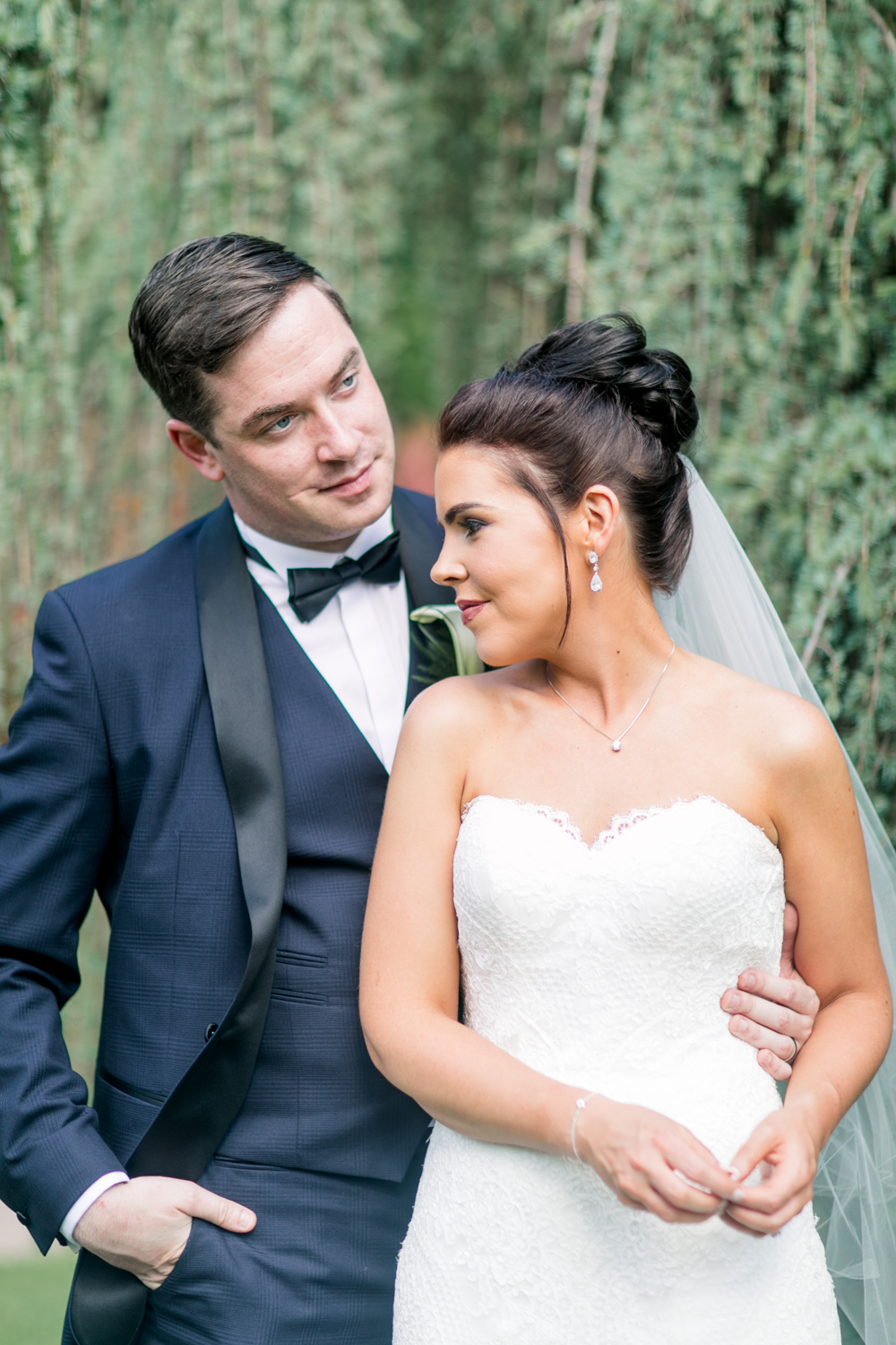 bride and groom with off shoulder wedding dress and navy tux