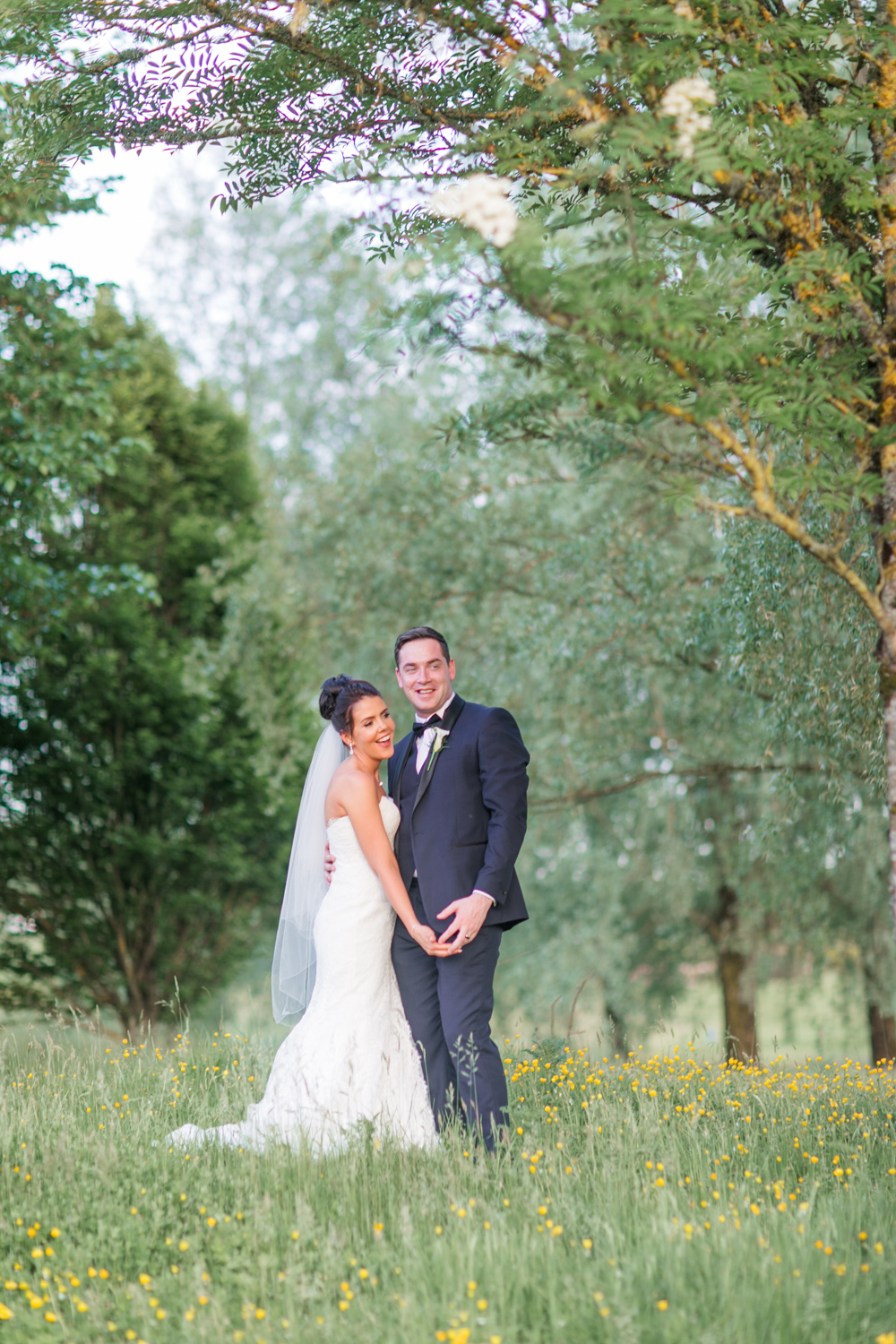 bride and groom in slieve russell hotel meadow during sunset