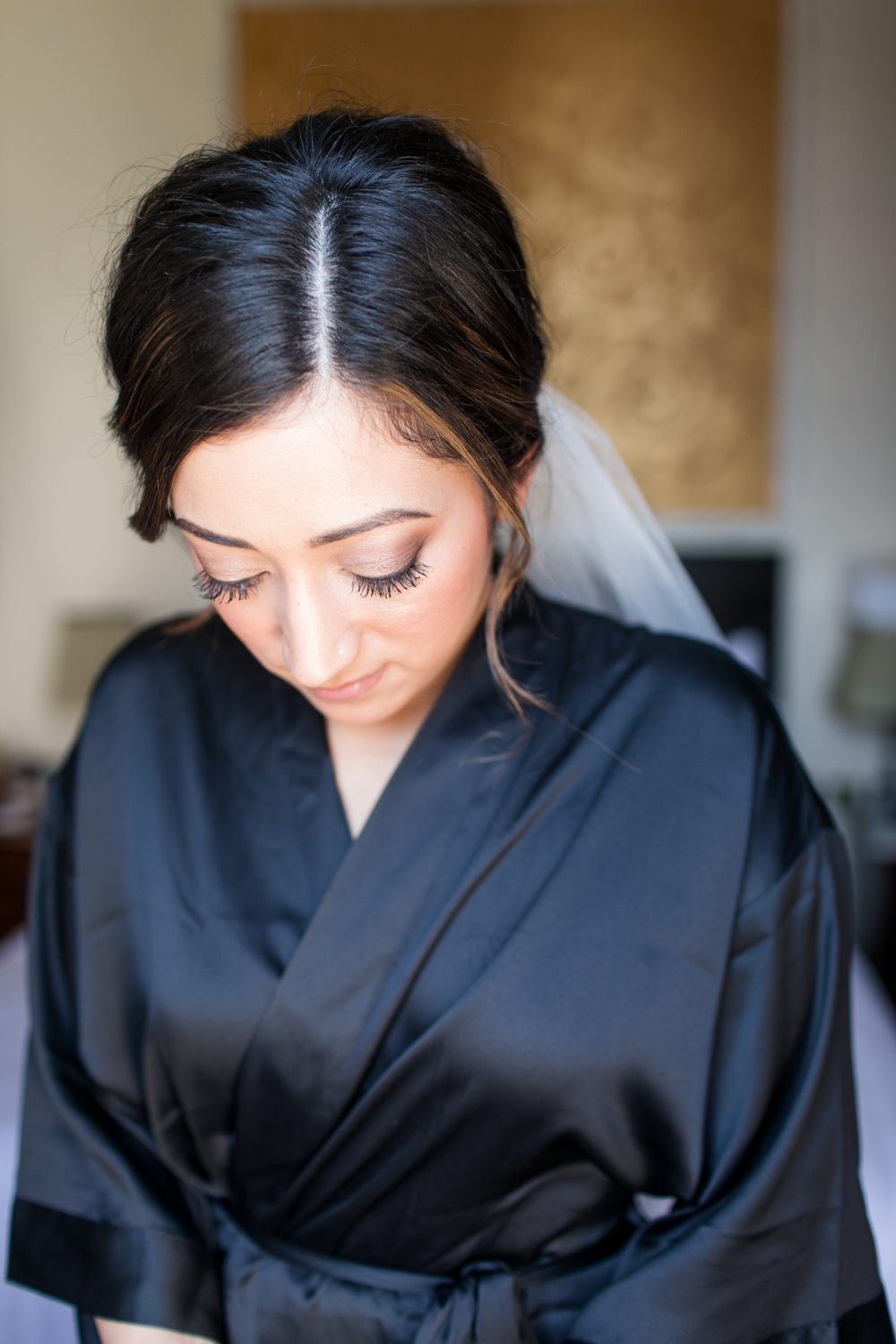 detail of bride's make up while she is getting ready natural and light wedding eyeshadow