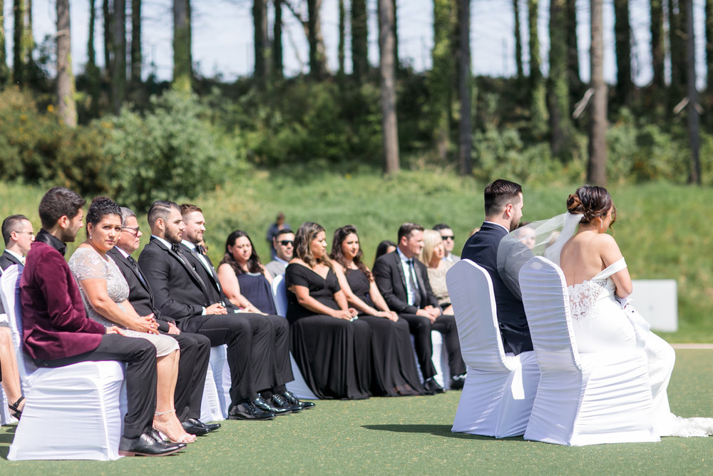 a black tie wedding ceremony held outside at powerscourt hotel in wicklow ireland