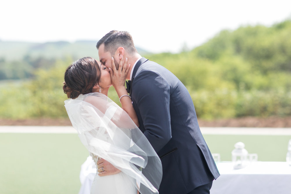 first kiss of a bride and groom outside powerscourt hotel in ireland