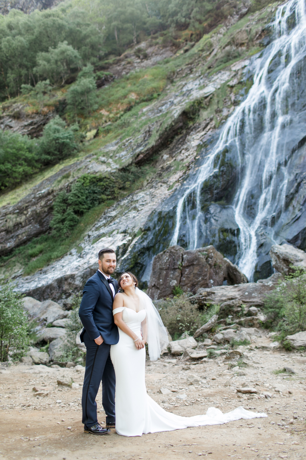irish landscape for an american couple elopement their wedding gowns are elegant and simple featuring black tie style