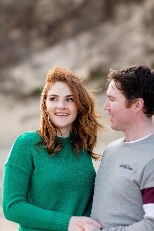 Red hair and green jumper engagement photoshoot at brittas bay ireland