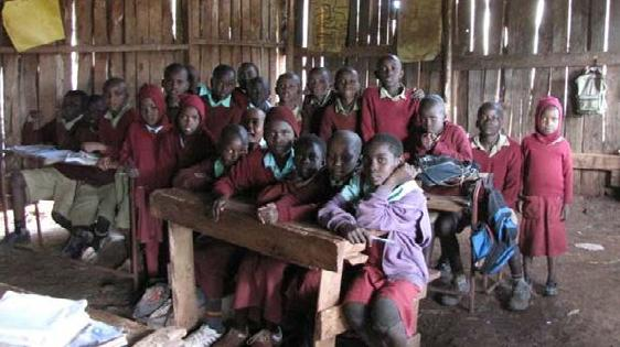 This is what school life was like in the old Ndurumuru classroom - earth floors, dark and cold - not a very productive learning environment