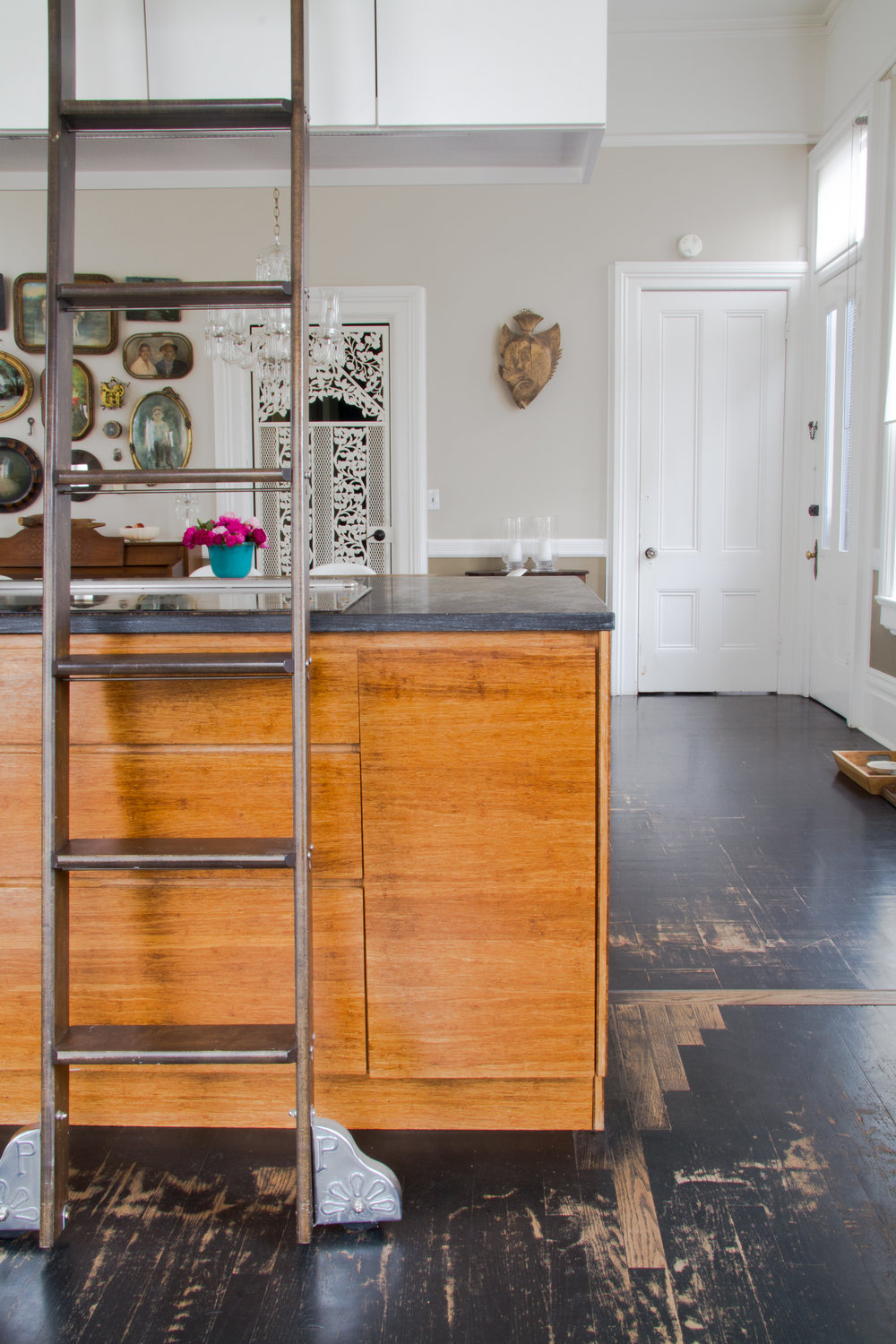 (5/21) The stained black floors reveal hints of natural oak.