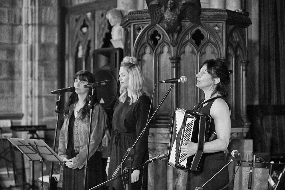 Kristen (Hatt) Lewis with Kate Ferris (far left) & Emma Perry at Todmorden Unitarian Church, Todmorden-England. Photo by Frank Roper.