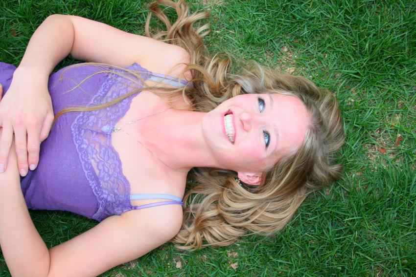 graduation portrait Kelli on grass