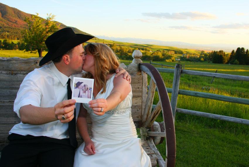 Wedding couple holding polaroid