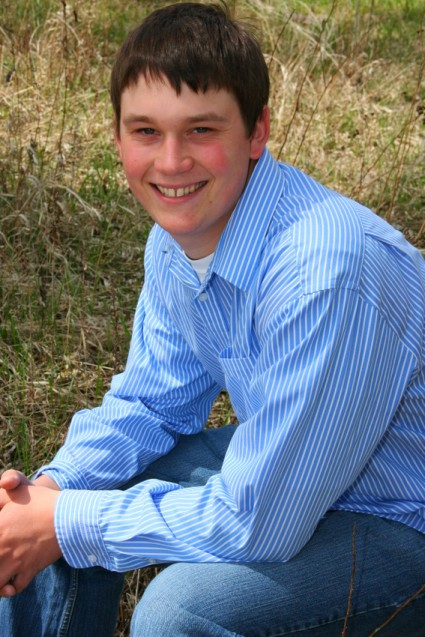 Senior portrait Luke in blue shirt