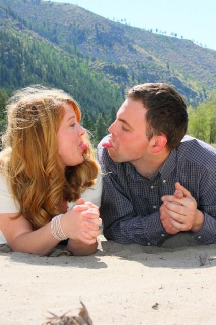 engagement portrait couple sticking tongues out