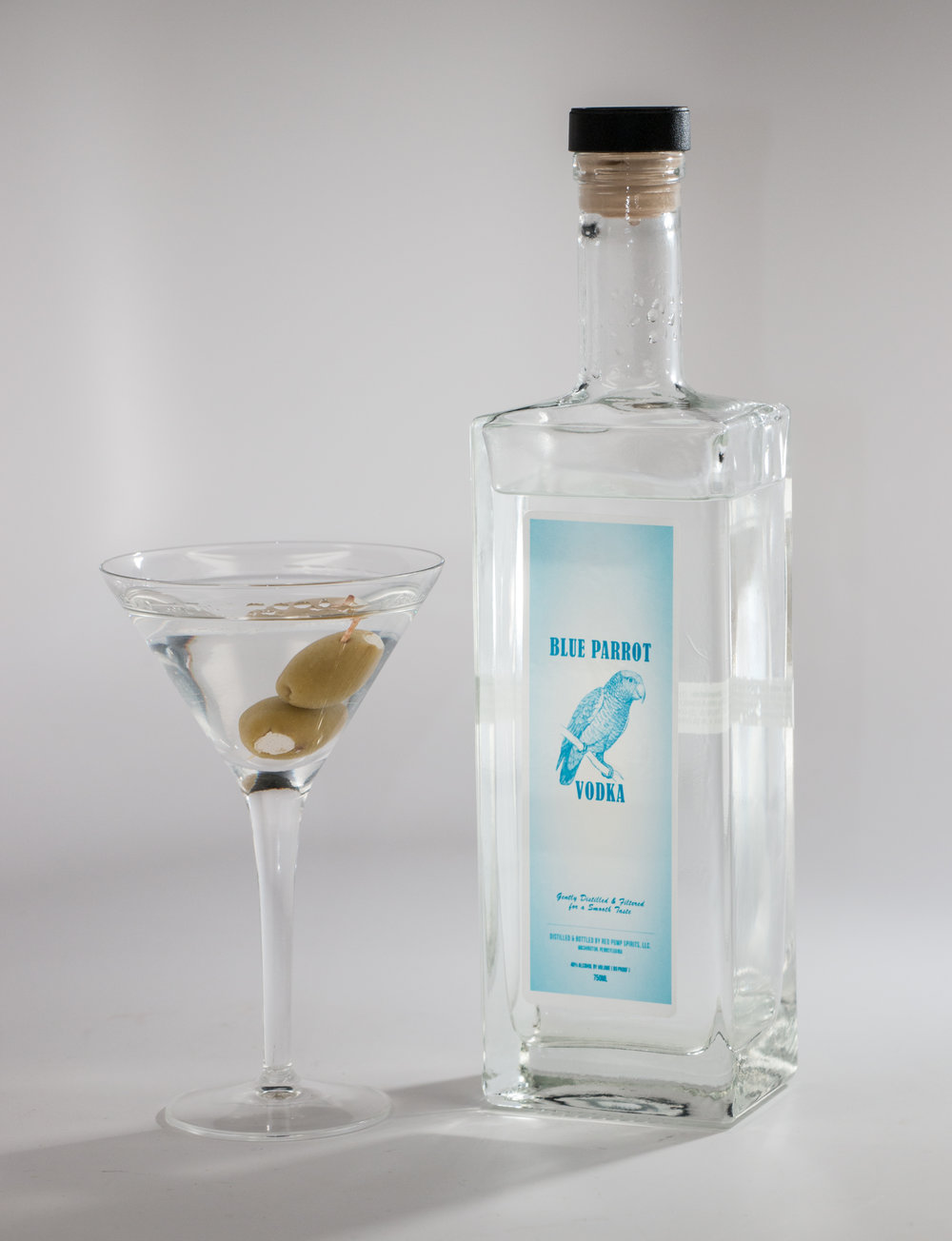 - Blue Parrot Premium Vodka is made from locally sourced wheat grain.  The spirit is distilled multiple times then slowly filtered through charcoal.  The smooth spirit can be either sipped neat or can be used as a base spirit for your favorite cocktail. If you think all vodkas are aroma and taste free spirits, then a sip of Blue Parrot Premium Vodka will be a pleasant surprise!We bottle it at 80 Proof / 40% ABV
