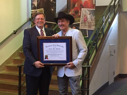 Louisiana Tech University President Les Guice presents Kix Brooks with the distinguished artist in residence award on Sept. 29 at the Howard Center for the Performing Arts on campus.