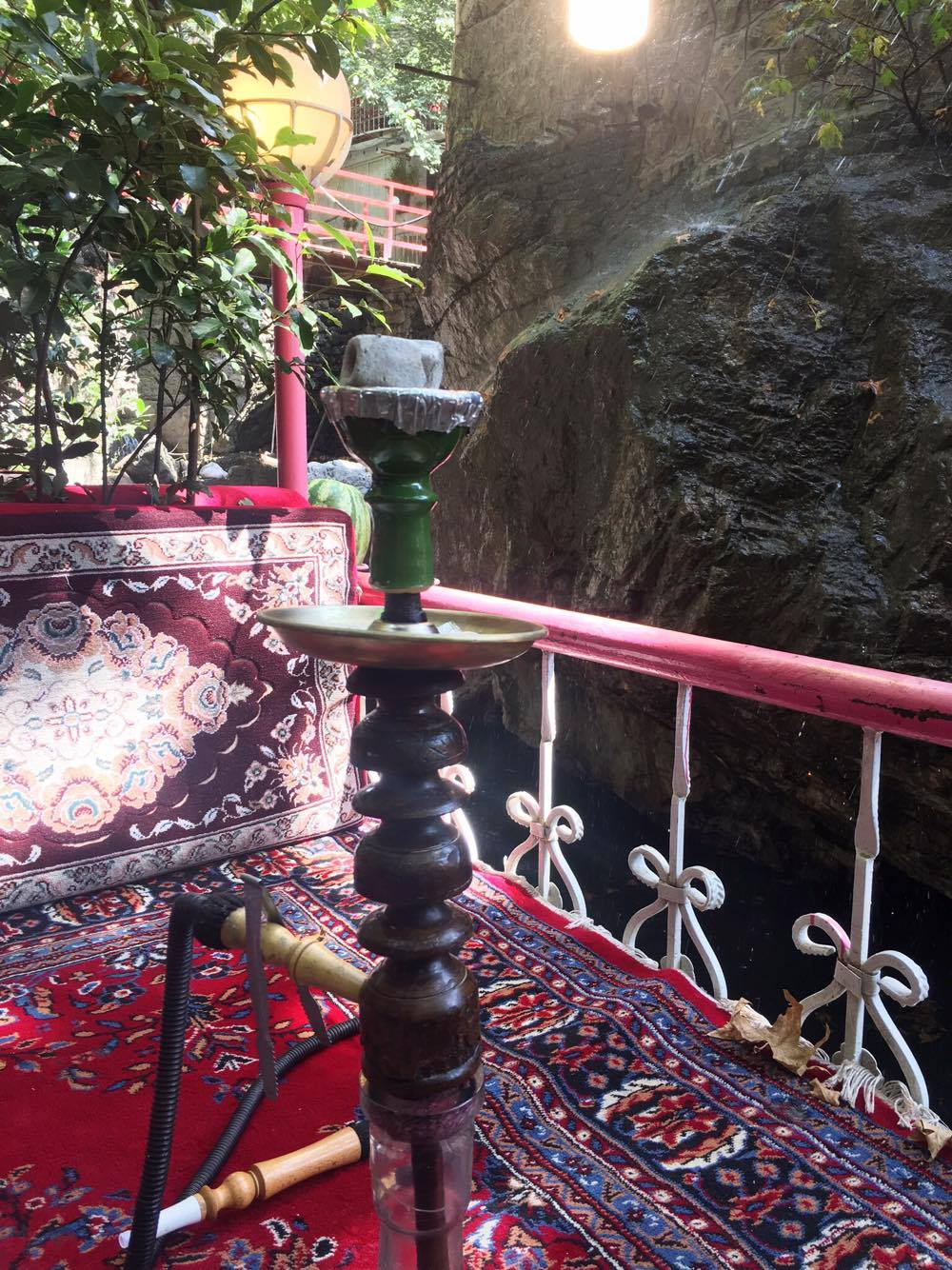 Smoking hookah somewhere in the mountains in Tehran.