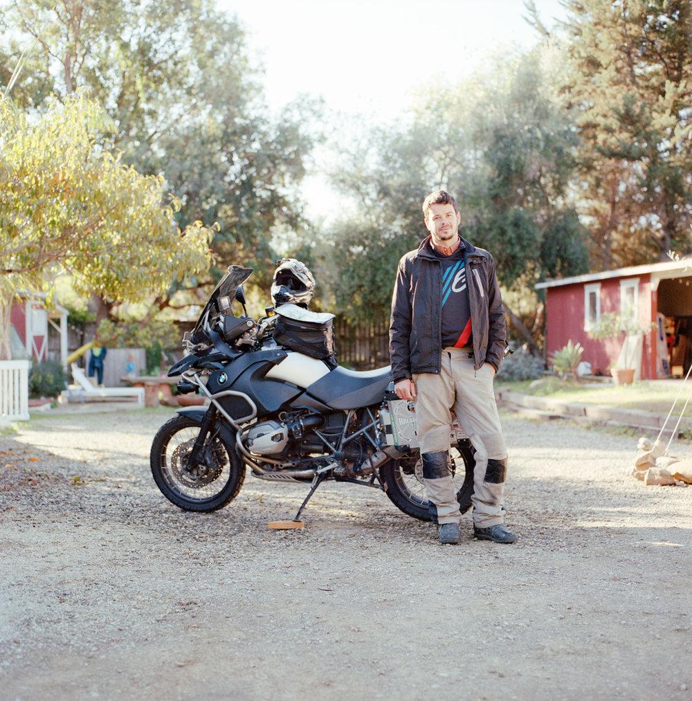 portrait of Alex Schodt and his Enduro BMW bike in Santa Barbara.