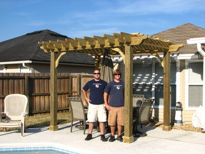 Derek Pratt and Adam Pratt in 2010, next to one of the first pergolas built by the brothers