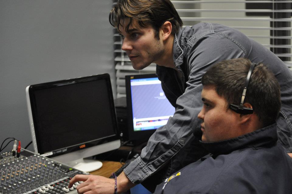 AOC Employee Jacob White instructs a student from Carencro High's Academy of Information Technology in our director's booth.
