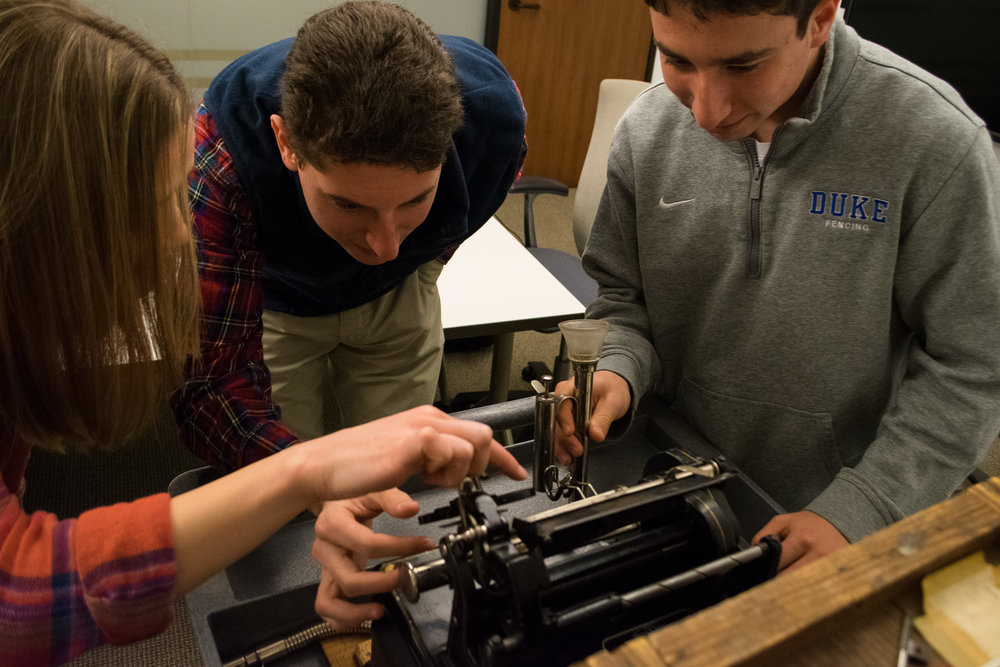 Students Inspecting Frank C Brown's Dictaphone