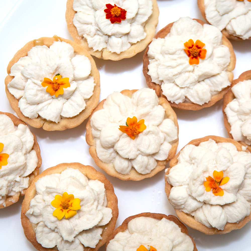 Miniature Pâte Sucrée Tarts with orange-spiced tea custard and honey whipped cream - Photo credit Clay Williams